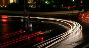 Motion Blur-Street. Traffic on city street in Bloemfontein, South Africa, during light rainstorm, long exposure and motion blurring of lights Royalty Free Stock Photos