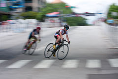 Motion Blur Of Teen Cyclist Racing In Athens Twilight Criterium Royalty Free Stock Photos