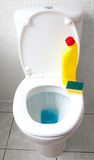 Motion blur of toilet flushing bleach stock photography