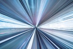 Motion blur of train moving inside tunnel with daylight in tokyo, Japan royalty free stock images
