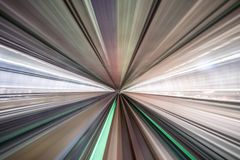Motion blur of train moving inside tunnel with daylight in tokyo, Japan royalty free stock image
