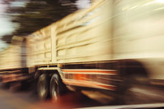 Motion blur of truck driving on highway.  Stock Photos