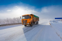 Motion blur of a truck on winter road on frosty day royalty free stock photo
