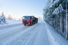Motion blur of a  truck on winter road on frosty sunny day Royalty Free Stock Photography