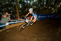 Motion blur UCI MTB World Cup Rider taking berm. Pietermaritzburg, South Africa - April 23 : Cross Country Final Men run at UCI MTB World Cup Round 1 2011 at Royalty Free Stock Photos