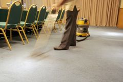 Motion blur Vacuum on carpet. Cleaning carpet with vacuum machine at meeting room Stock Photos