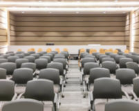 Motion blur of view of empty seminar after finish meeting and audience go out in a seminar room background Stock Images