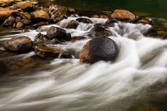 Cascade waterfall. Motion blur of water flow at the beautiful tropical cascade waterfall Stock Photography
