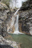 Motion blur of waterfall. Long exposure shot of water flowing stock photo