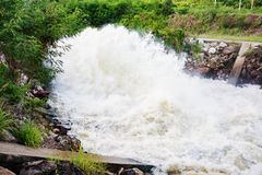 Motion blur of waterfall from overflow of dam on rainy season, N. Akhonsawan, Thailand stock image