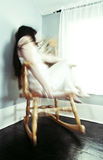 Woman in rocking chair Stock Images
