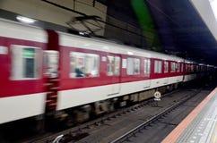 Motion blured subway train at Kintetsu Nara station Stock Photos