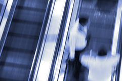 Motion blurred. People motion blurred at elevator to airport Royalty Free Stock Photos