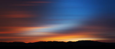 Motion blurred abstract of colorful sunset Stock Image