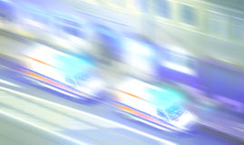 Motion blurred ambulances with flashing lights at night. Royalty Free Stock Photo