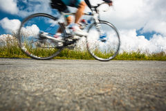 Motion blurred biker Stock Image