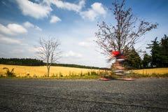 Motion blurred biker Stock Photo