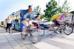Motion blurred bikes in traffic. Motion blurred bicyclists in traffic Royalty Free Stock Image