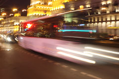 Motion blurred bus. In the evening on the street stock photo