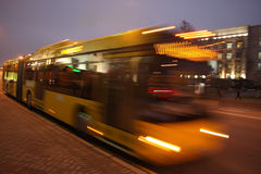 Motion blurred bus. Public transportation bus is moving in the evening royalty free stock images