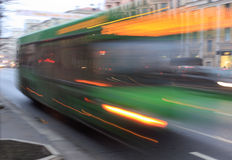 Motion blurred bus. On the street at dusk royalty free stock photography