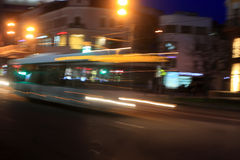 Motion blurred bus. Bus on the street at night. Movement blur effect royalty free stock images