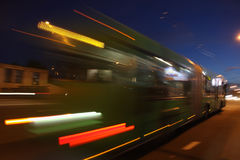 Motion blurred bus. Traffic bus on the street late at night with motion blur royalty free stock photography