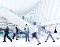 Motion blurred business people in the office Stock Photography