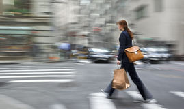 Motion blurred business people walking on the street Stock Photos
