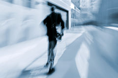 Motion blurred business people walking on the street royalty free stock photography
