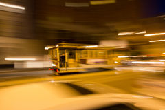 Blurred movement on San Franciscos Cable Car. A motion blurred cable car traveling down California Street in San Francisco, California. A random passenger sits Royalty Free Stock Photography