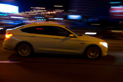 Motion blurred car. Movement of a blurred car in the city at night stock photo