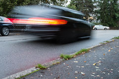 Motion blurred car with red backlight Royalty Free Stock Photography