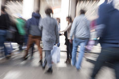 Motion blurred commuters. A motion blurred commuters and pedestrian Stock Image