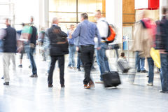 Motion blurred commuters. People in interior Stock Images