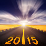 Motion blurred empty asphalt road forward to new year Royalty Free Stock Photos