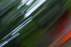 Motion blurred foliage abstract nature  blur  green background.  Stock Photography