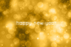 Motion blurred happy new year golden bokeh illustration Stock Photos