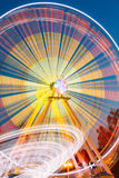 Motion Blurred Of High Speed Rotating Attraction Amusement Park. Royalty Free Stock Photos