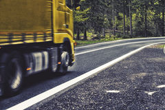 Motion blurred highway in forest, Stock Images