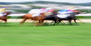 Motion blurred horse race Stock Images
