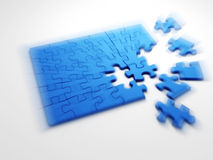 Motion blurred image of collecting puzzle Royalty Free Stock Photo