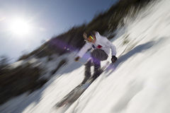 Motion blurred image of an expert skier. Stock Images