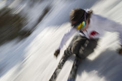 Motion blurred image of an expert skier. Stock Image