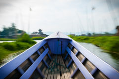 Motion Blurred Lila boat driving on Inle Lake Stock Images