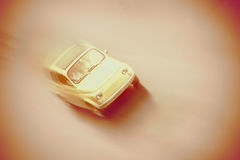 Motion blurred little old retro car in vintage style. Stock Photography