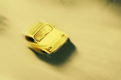Motion blurred little old retro car in vintage style. Royalty Free Stock Photos