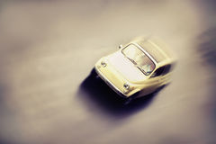 Motion blurred little old retro car in vintage style. Stock Photo