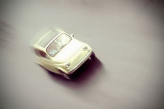Motion blurred little old retro car in vintage style. Royalty Free Stock Image