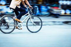 Motion blurred of a man biker. Shoot photo with DSLR camera in light nature real time Royalty Free Stock Photo